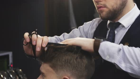 Thumbnail for Cropepd Shot of a Professional Barber Cutting Hair of His Male Client