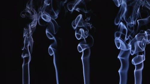 White Smoke Floating in Space on a Black Background in Slow Motion
