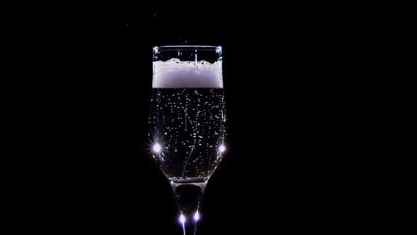 Thumbnail for Slow Motion. Bubbles of Champagne Wine Sparkling in a Glass