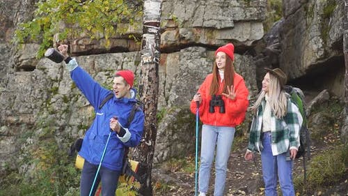 Enthusiastic Happy Tourists on Mountains or Rocks