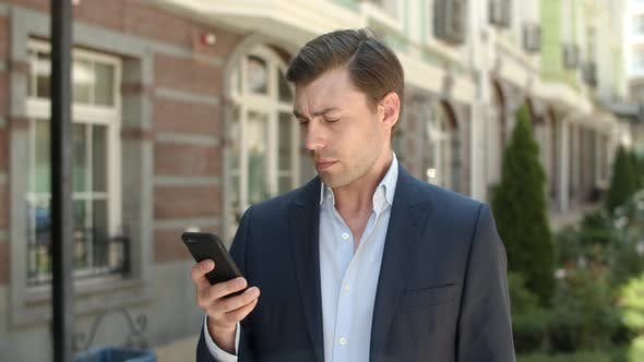 Thumbnail for Closeup Businessman Typing Messages at Street. Man Using Smartphone at Street