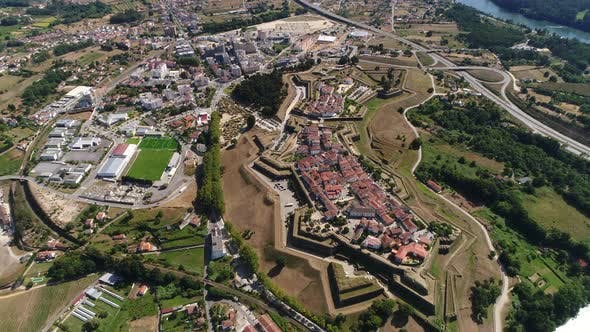 Aerial View of Village Surrounded by Fortress
