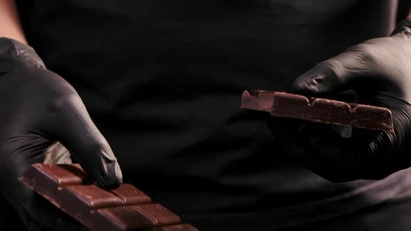 Thumbnail for Man in Black Gloves Breaking Chocolate