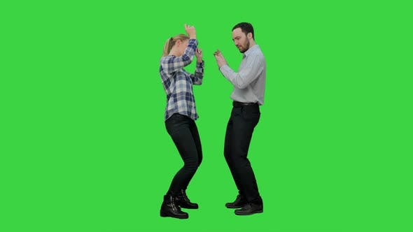 Thumbnail for Young Couple Dancing Together on a Green Screen, Chroma Key