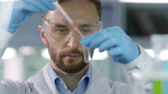 Thumbnail for Male Scientist Carrying out Research in Laboratory