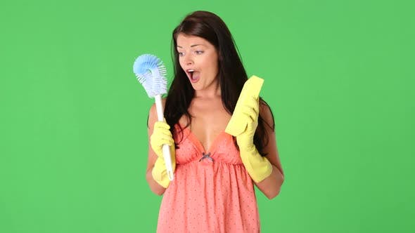 Thumbnail for Cute young woman holding toilet brush and sponge