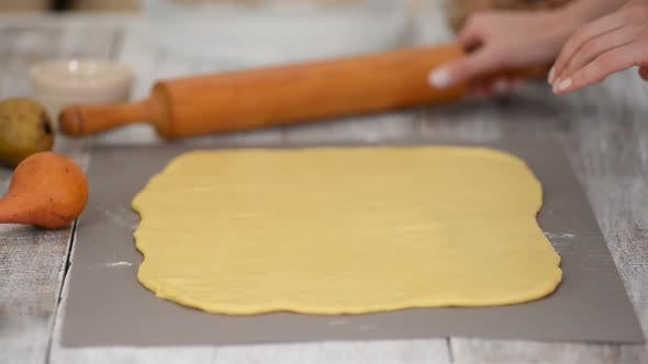 Thumbnail for Girl Is Preparing a Cinnabon with Pear Filling. Sweet Homemade Pastry.