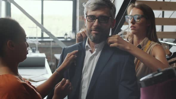 Thumbnail for Businessman Trying on Custom Suit in tailoring Studio