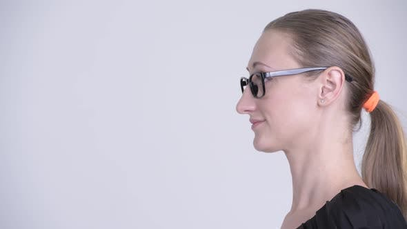 Thumbnail for Closeup Profile View of Happy Blonde Businesswoman Smiling