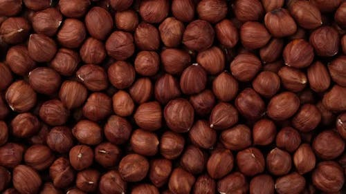 hazelnuts top view, rotation. Healthy food concept. 4K UHD video