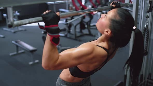 Thumbnail for Strong Woman Doing Pull-ups in the Gym