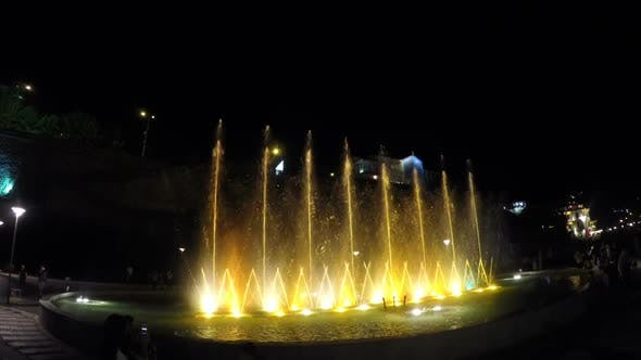 Thumbnail for Illuminated Fountain, Water Jets Crisscrossing and Going Up, Splashes in Air