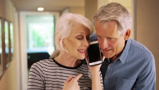 Thumbnail for Old couple talking to family on smartphone
