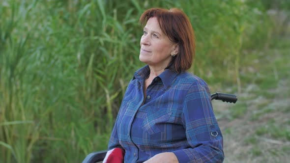 Elderly Woman on Wheelchair on Nature