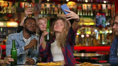Friends are Taking Selfie with Smartphone in Bar