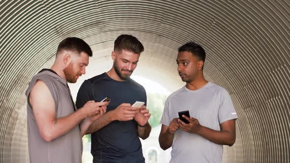 Thumbnail for Sporty Men or Friends with Smartphones Outdoors