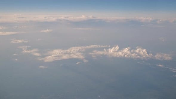 View From Inside Window of Flying Airplane