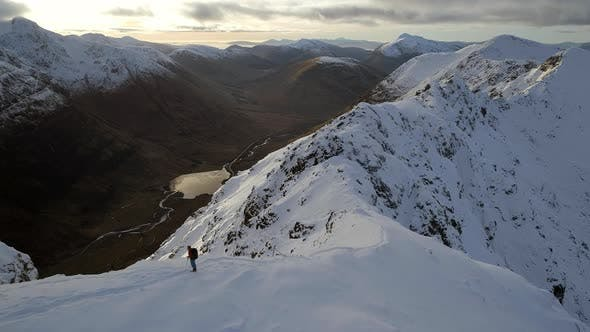 Thumbnail for Mountain Climber Surveying a Ridge in the Sunny Afternoon