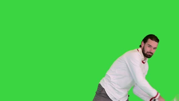 Young Man Doing Imitation of Playing Tennis on a Green Screen Chroma Key