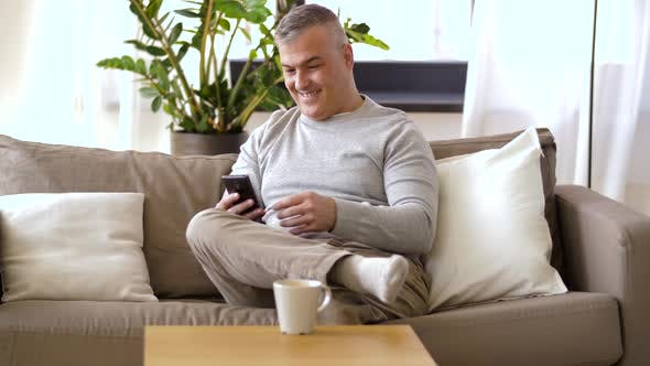 Thumbnail for Man with Smartphone Drinking Coffee at Home 35