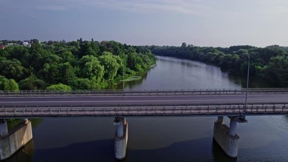 Car Driving Over Bridge