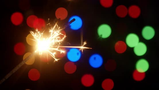 Thumbnail for Christmas Sparkler. On a Black Background.