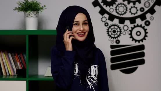 Thumbnail for Young Muslim Girl Uses Smartphone