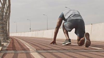 Black Man Sprinting Outdoors
