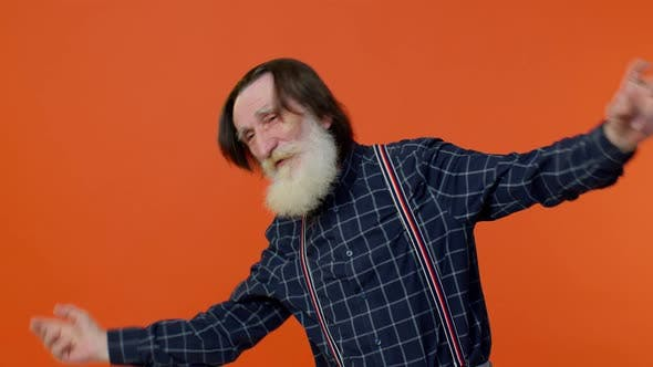 Elderly Bearded Grayhaired Grandfather Man Listening Music Smiling Dancing to Music Having Fun