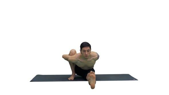 Thumbnail for Man in Seated Marichyasana yoga pose stretching leg and