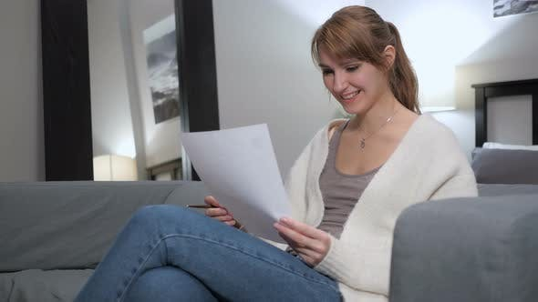 Thumbnail for Woman Excited after Reading Documents