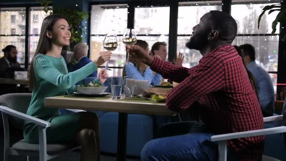Thumbnail for Young Couple Raising and Clinking Glasses of Wine