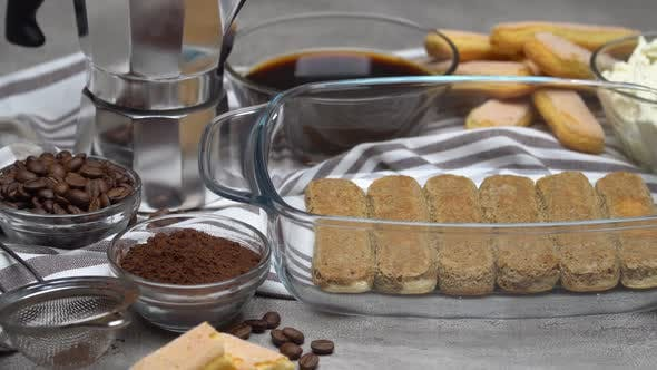 Cover Image for Ingredients for Traditional Tiramisu Cake on Concrete Background