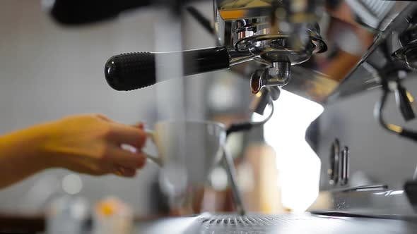 Thumbnail for Unrecognizable Barista Woman Attaching Portafilter, Placing Cup Under Dispenser of Professional