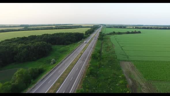 Thumbnail for Cars Driving Along a Country Road in the Woods on a Summer Day. Aerial Shot