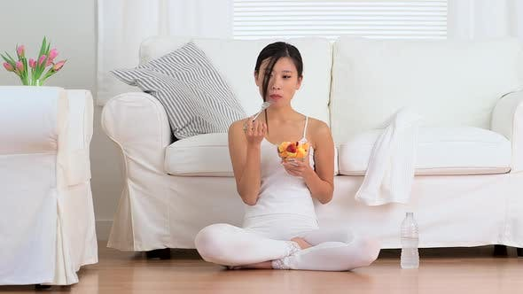 Thumbnail for Happy Asian woman eating fruit