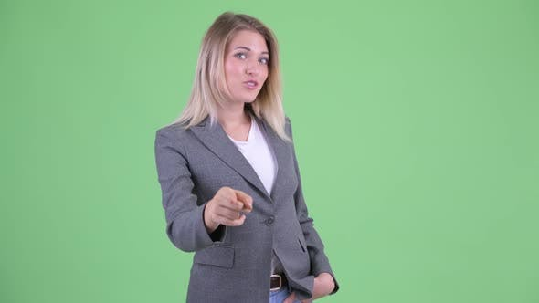 Thumbnail for Happy Young Beautiful Blonde Businesswoman Pointing at Camera
