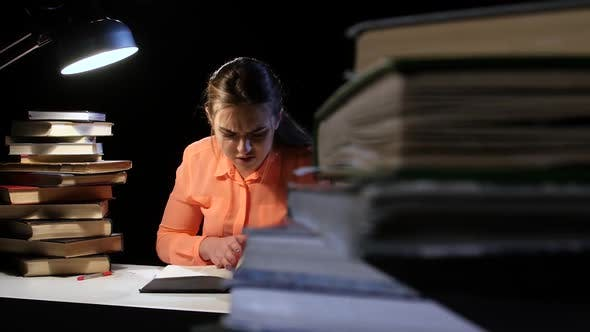 Thumbnail for Girl Goes Through a Lot of Books and Can Not Find the Desired Information. Black Background