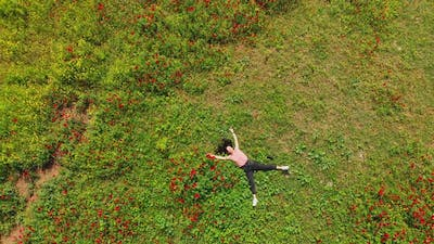 Girl Lays On Ground In Spring Relaxed Top View
