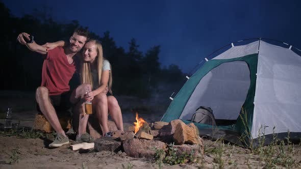 Thumbnail for Loving Couple Tent Camping on Beach Taking Selfie