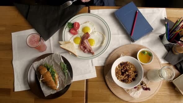 Thumbnail for Restaurant Delicious Breakfast with Sunny Side Up Fried Eggs, Bacon, Coffee Vegetables and Greens