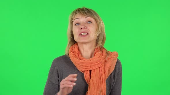 Thumbnail for Portrait of Middle Aged Blonde Woman Is Talking About Something Then Making a Hush Gesture, Secret