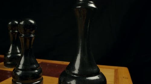 Closeup Dolly Macro Shot of a Black Wooden Chess King on a Chessboard