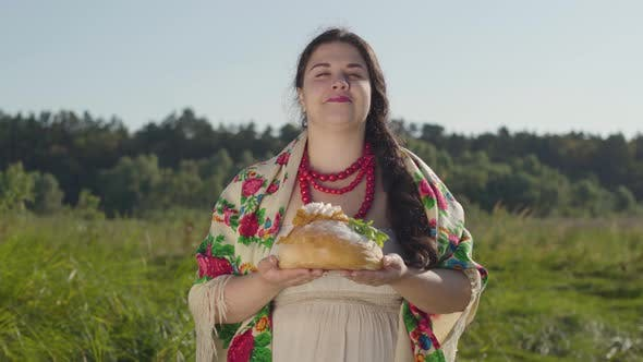 Thumbnail for Portrait of Beautiful Overweight Woman Proposing Lard on the Loaf of White Bread Smiling