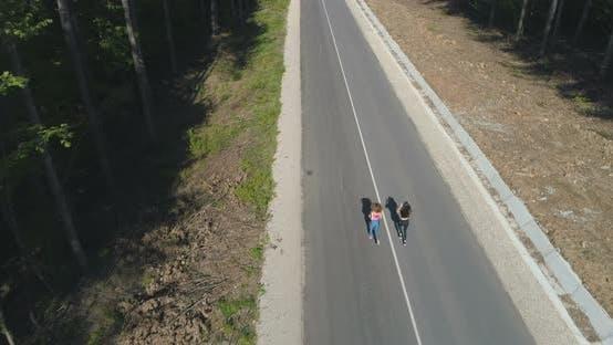 Thumbnail for Fit Female Athletes Running on Asphalt Road