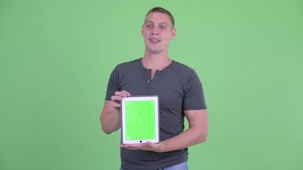 Thumbnail for Happy Young Man Talking While Showing Digital Tablet
