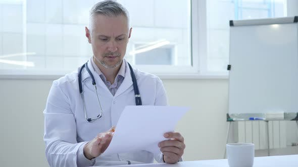 Thumbnail for Doctor Reading Medical Papers in Clinic