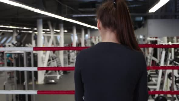A Young Woman Trains Her Punches  Shadow Boxing