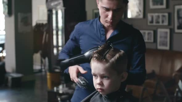 Thumbnail for Drying Hair of Kid in Barbershop