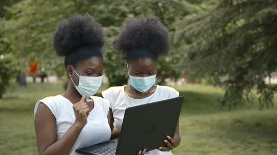 Two Black Girls Students with Laptop in Park